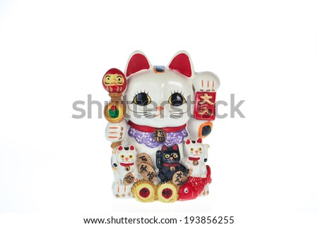 Japan lucky cat souvenir isolated on white - stock photo