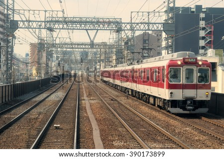 JAPAN - MARCH 2016: Local Kintetsu train and rail road from Kyoto to Osaka. Kintetsu Railways is the Japan's largest non-JR railway network. Its operation are in Nagoya and Kansai area.