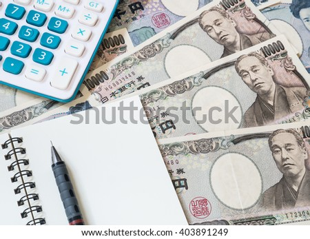 Japan money - Calculator, notebook and pencil on Japanese yen currency  - stock photo