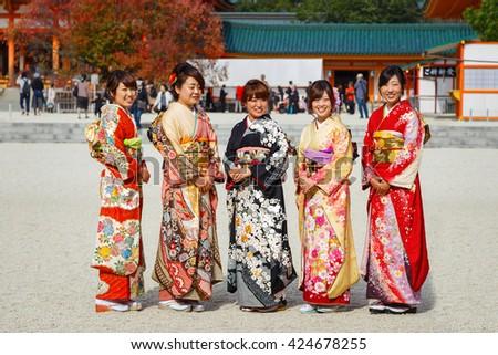 JAPAN - NOVEMBER 22 2015: Beautiful Japanese ladies in traditional kimono dress at Heian-jingu shrine, kyoto - stock photo