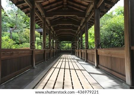 Japan temple wood walk way with Japanese garden , Kyoto Temple Japan - stock photo