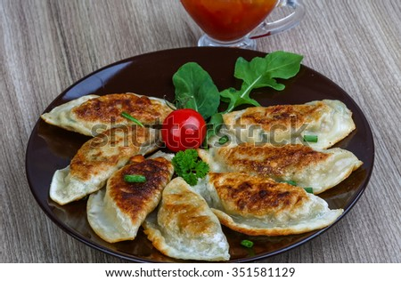 Japan traditional cuisine - fried Gyoza with sweet sauce - stock photo