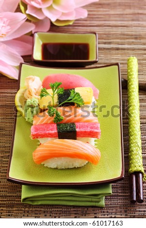Japan traditional food sushi on green plate - stock photo