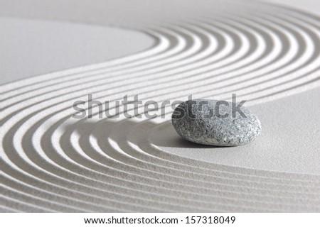 Japan ZEN garden in sand with stone - stock photo