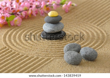 Japan zen garden with stacked stones in sand