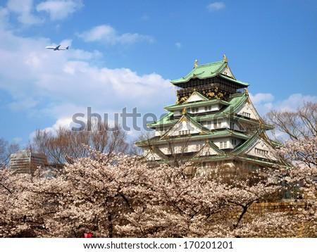 Japanese ancient castle with Sakura blossom - stock photo