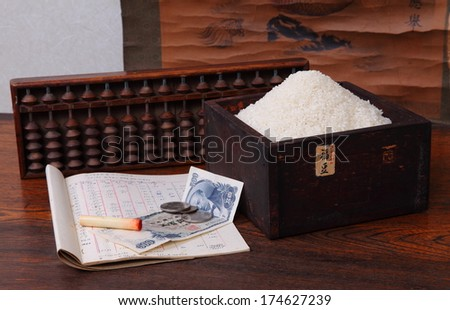 Japanese antique desk, abacus, measuring box and scroll/Old Japan/Antique Japanese objects arranged with an old business ledger, bone seal, old currency and freshly harvested rice.  - stock photo