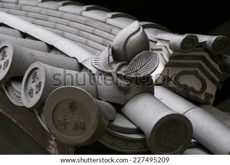 Japanese architecture of the amulet, peach tile, Kyoto, Japan - stock photo