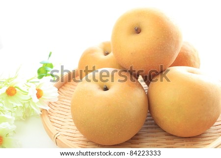Japanese autumn fruit, pear on basket
