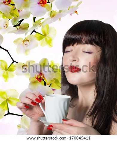 Japanese Beautiful Girl with a cup aromatic beverage.Spring