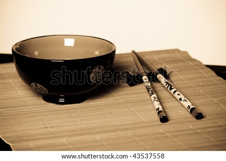 Japanese bowl and sticks. Eastern style. - stock photo