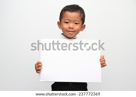 Japanese boy and a message board - stock photo