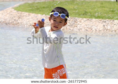 Japanese boy with water gun (3 years old) - stock photo