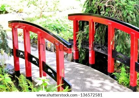 Japanese bridge portrait in the park - stock photo