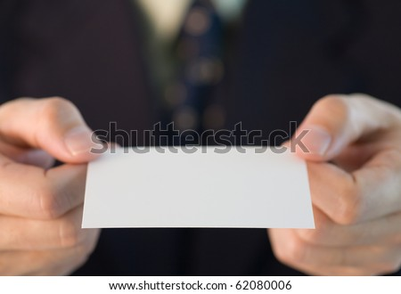 Japanese business custom of giving a business card with two hands - stock photo
