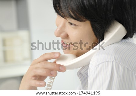 Japanese Business Man talking on a phone - stock photo