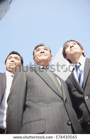 Japanese businessman standing on the street - stock photo