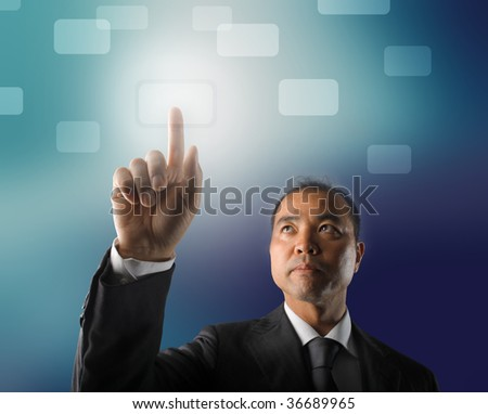 japanese businessman touching a digital button - stock photo