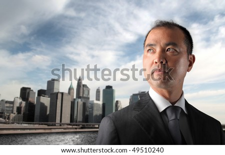 Japanese businessman with cityscape on the background - stock photo