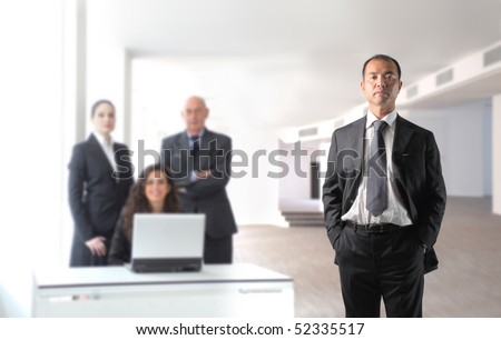 Japanese businessman with group of business people on the background - stock photo