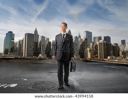 japanese businessman with modern city on the background - stock photo
