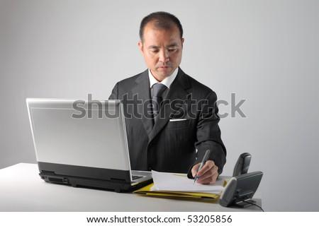 Japanese businessman working - stock photo