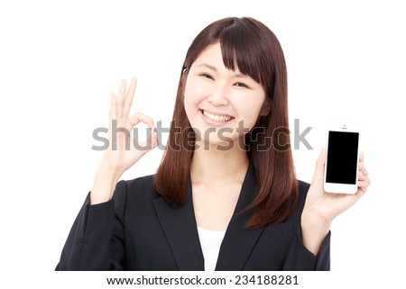 Japanese businesswoman OK gesture with the smart phone