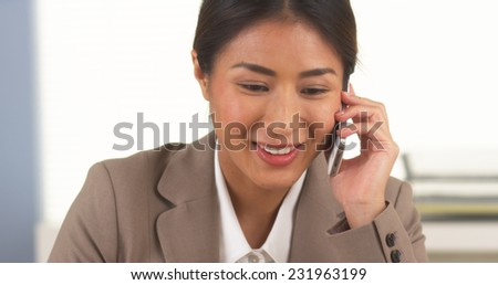 Japanese businesswoman talking on smartphone