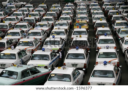 Japanese Cabs Lined Up at Sendai Station - Yellow Cab Contrasting - 2 - stock photo
