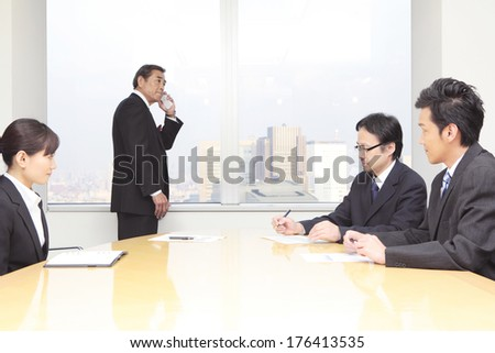 Japanese CEO and colleagues meet - stock photo