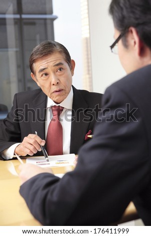 Japanese CEO of company in a meeting - stock photo
