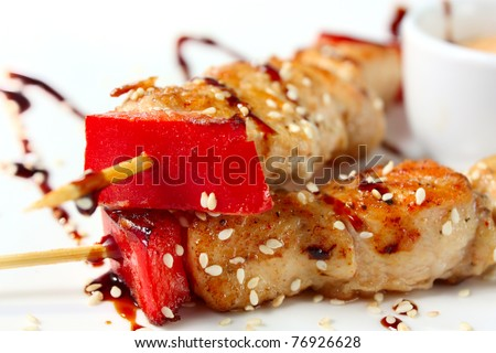 Japanese chicken kebabs . Traditional Oriental food. Tasty and nutritious - stock photo