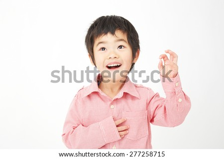 Japanese child makes funny face - stock photo