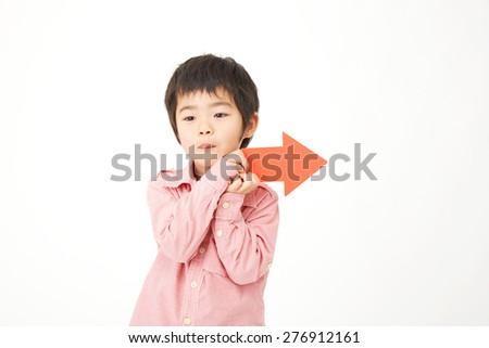 Japanese child pointing side - stock photo