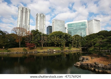 Japanese commercial buildings behind a city park in tokyo, Japan