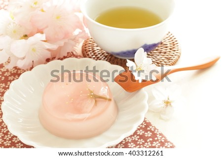 Japanese confectionery, edible flower Sakura in Kanten Jelly with green tea - stock photo