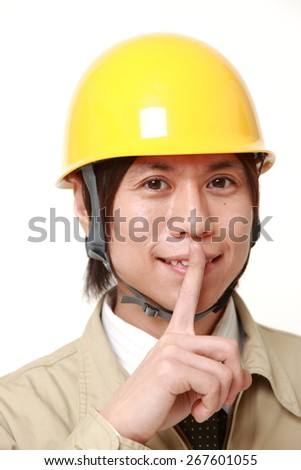 Japanese construction worker whith silence gestures - stock photo