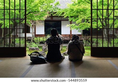 Japanese couple contemplating zen garden in Kyoto (Kennin-ji)