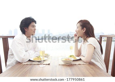 Japanese Couple eating lunch while talking - stock photo
