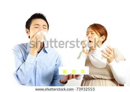 Japanese Couple sneezing - stock photo