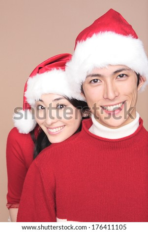 Japanese couple wearing a Christmas Santa hat