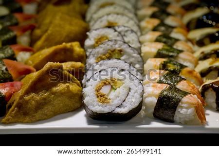 Japanese Cuisine -Buffet catering style Sushi Set in restaurant - salmon Maki Sushi and Nigiri Sushi - stock photo