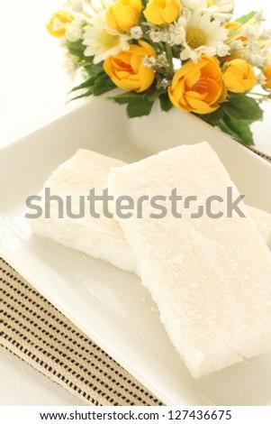 japanese  cuisine, frozen sticky rice cake Mochi on dish with flower - stock photo