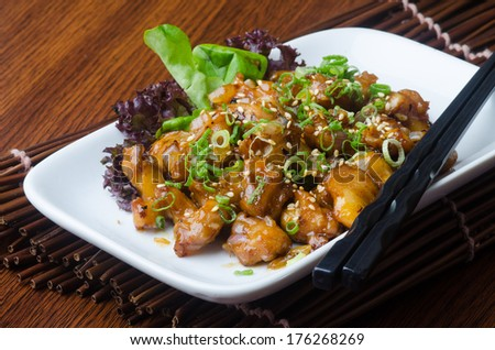 japanese cuisine. fry sauce chicken on background - stock photo