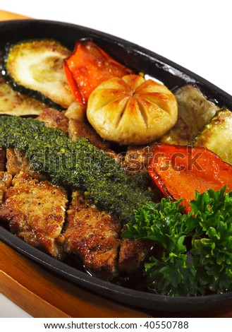 Japanese Cuisine - Grilled Pork with Roasted Vegetables and Mushrooms. Garnished with Basil Pasta and Fresh Parsley