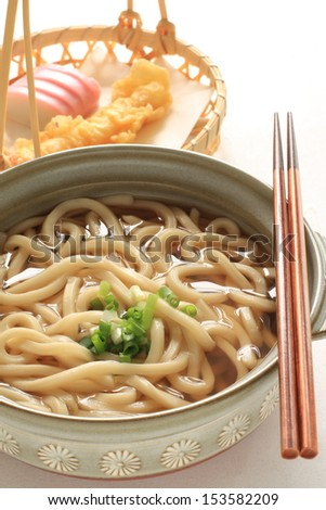 Japanese cuisine, hot pot Udon noodle with tempura on background - stock photo
