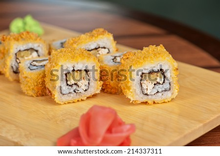 Japanese cuisine - hot sushi roll - stock photo