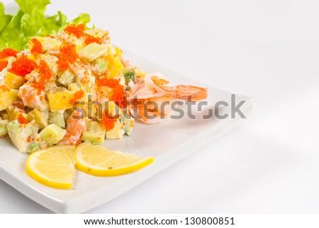 Japanese Cuisine - Mango Salad Served with Lemon and royal shrimp - stock photo