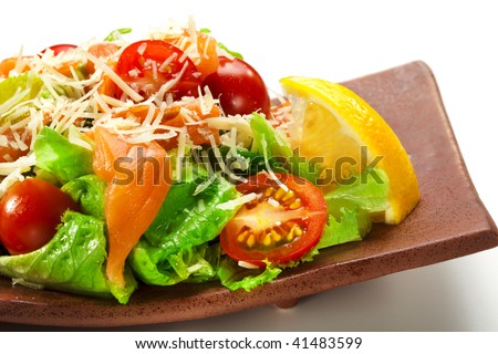 Japanese Cuisine - Salad made of Fresh Salmon, Salad Leaf, Cherry Tomato, Lemon and Parmesan Cheese - stock photo