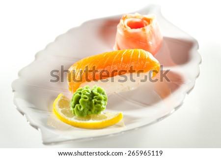 Japanese Cuisine -  Salmon Nigiri Sushi with Ginger and Wasabi - stock photo